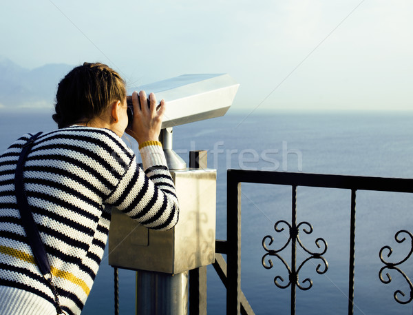 young woman looking through telescope at sea viewpoint in Ataturk park Stock photo © iordani