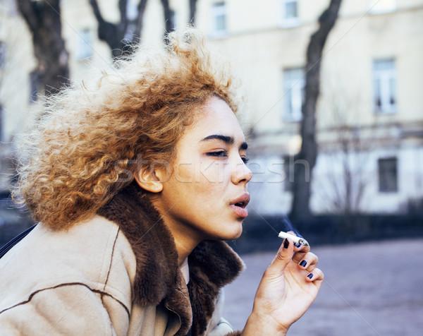 young pretty girl teenage outside smoking cigarette close up, lo Stock photo © iordani