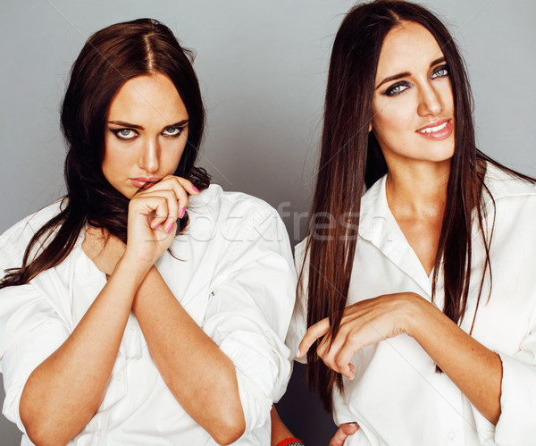 two sisters twins girl posing, making photo selfie, dressed same Stock photo © iordani