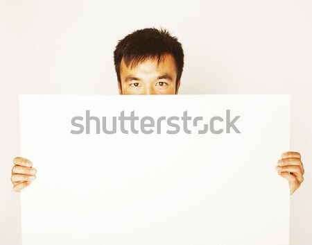 pretty cool asian man holding empty white plate smiling Stock photo © iordani
