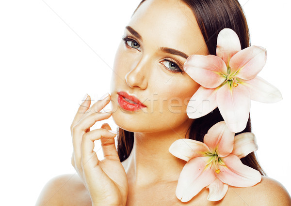 young attractive lady close up with hands on face isolated flower lily Stock photo © iordani