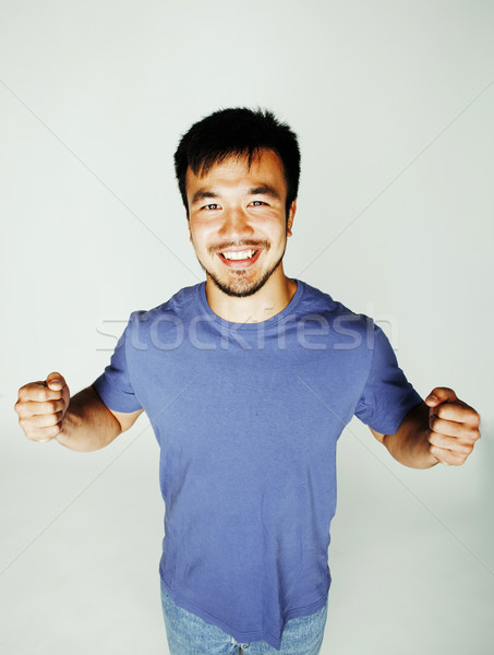 Stock photo: young cute asian man on white background gesturing emotional, posing lifestyle people concept