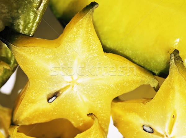 delicious carambola asian exotic fruit on white background isola Stock photo © iordani