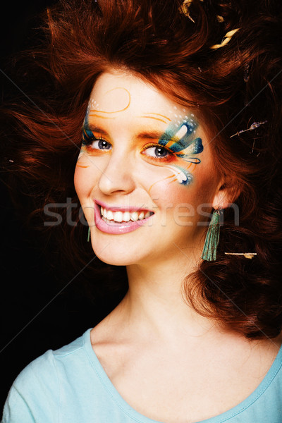pretty funny girl with art make up, closeup floral print on face Stock photo © iordani
