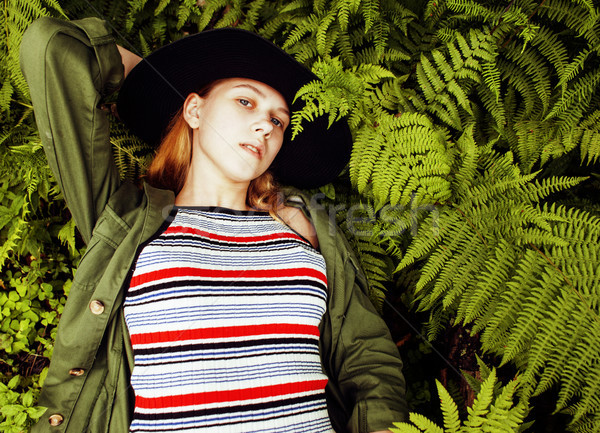 Pretty young blond girl hipster in hat among fern, vacation in green forest, lifestyle fashion peopl Stock photo © iordani