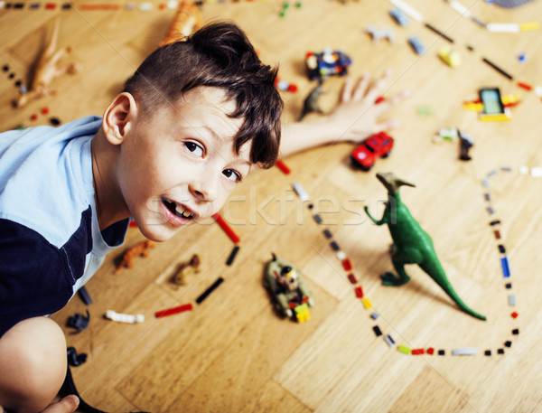 little cute preschooler boy among toys lego at home happy smiling, lifestyle people concept Stock photo © iordani