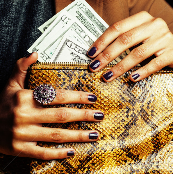 pretty fingers of african american woman holding money close up with purse, luxury jewellery on pyth Stock photo © iordani