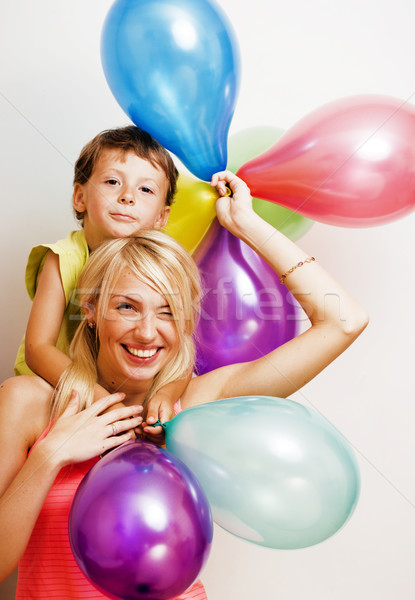 pretty family with color balloons on white background, blond woman with little boy at birthday Stock photo © iordani