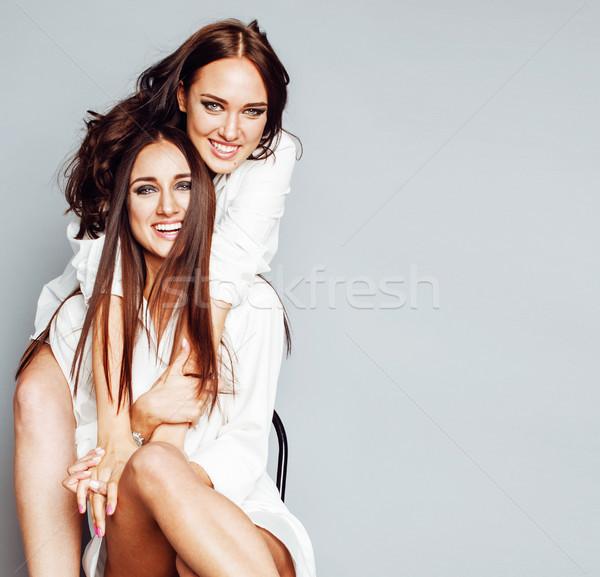 Dwa siostry bliźnięta dziewczyna stwarzające Zdjęcia stock © iordani