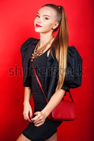 young pretty woman young lady posing on red background, lifestyle people concept Stock photo © iordani