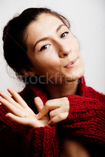 young pretty woman in sweater and scarf all over her face, lifes Stock photo © iordani