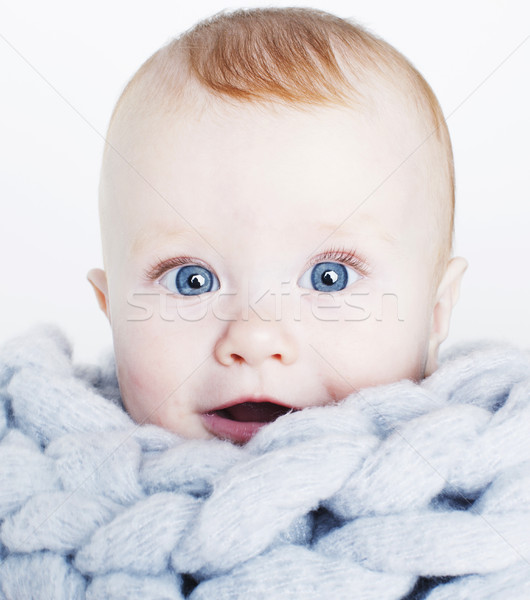 little cute red head baby in scarf all over him close up isolate Stock photo © iordani