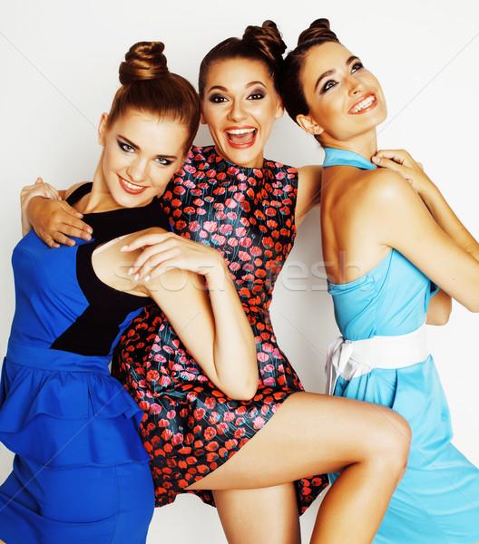 Grupy różnorodny elegancki damska jasne suknie Zdjęcia stock © iordani