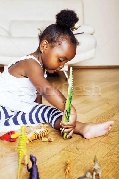 little cute african american girl playing with animal toys at ho Stock photo © iordani