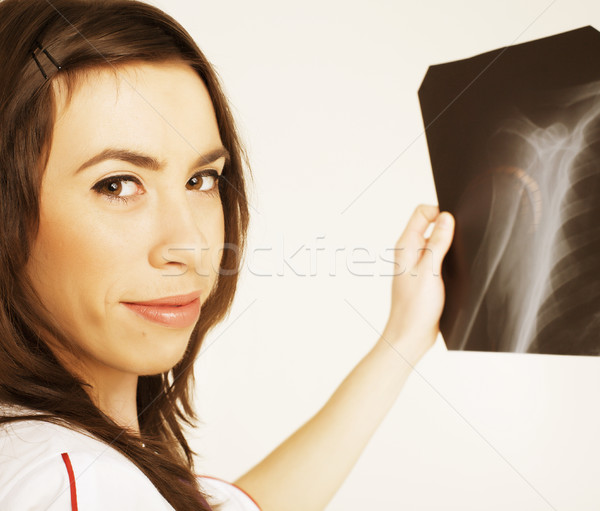 close up portrait of young doctor with x ray shot in hands Stock photo © iordani