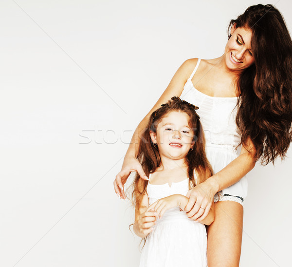 young mother with little cute daughter emotional posing on white Stock photo © iordani