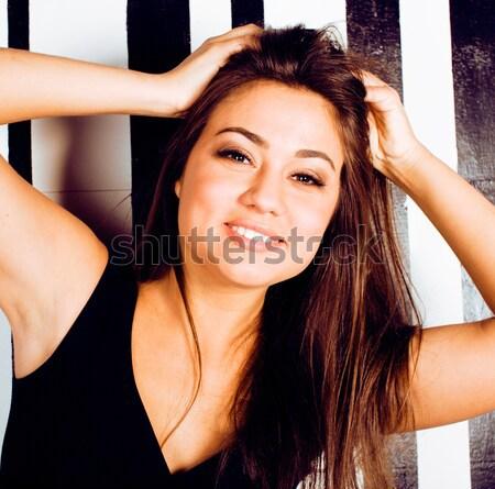 Fiatal csinos hideg kövér barna hajú nő Stock fotó © iordani