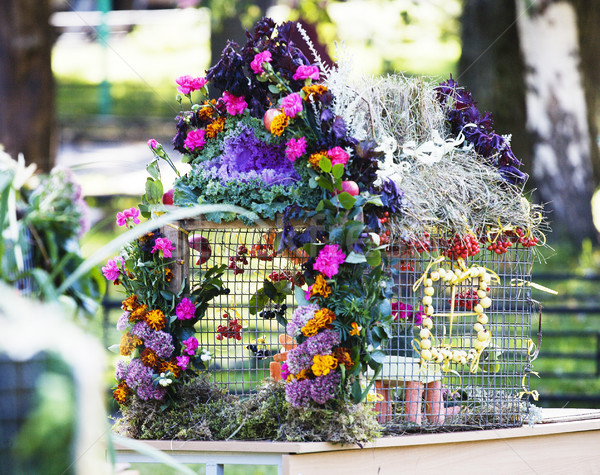 Stock photo: picture of bright decorated with flowers bird house