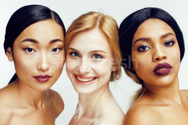 different nation woman: asian, african-american, caucasian together isolated on white background hap Stock photo © iordani