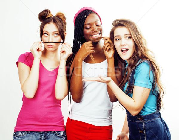 Różnorodny naród dziewcząt grupy znajomych Zdjęcia stock © iordani