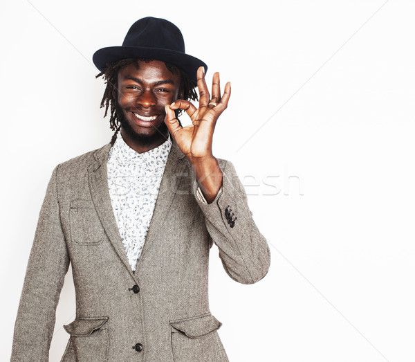 young handsome afro american boy in stylish hipster hat gesturing emotional isolated on white backgr Stock photo © iordani