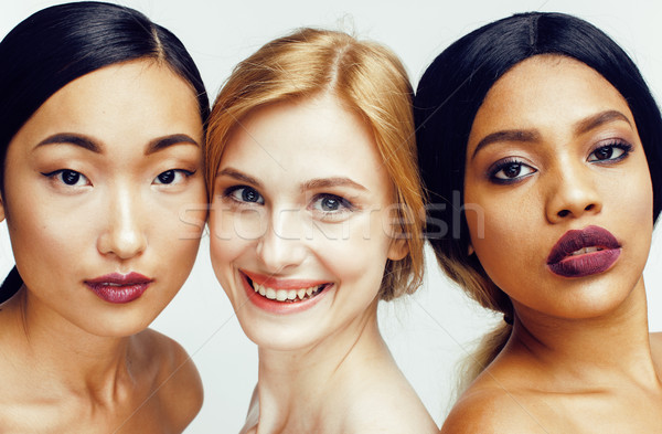 different nation woman: asian, african-american, caucasian together isolated on white background ha Stock photo © iordani