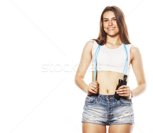 Genç güzel kadın halat yalıtılmış beyaz izlerken Stok fotoğraf © iordani