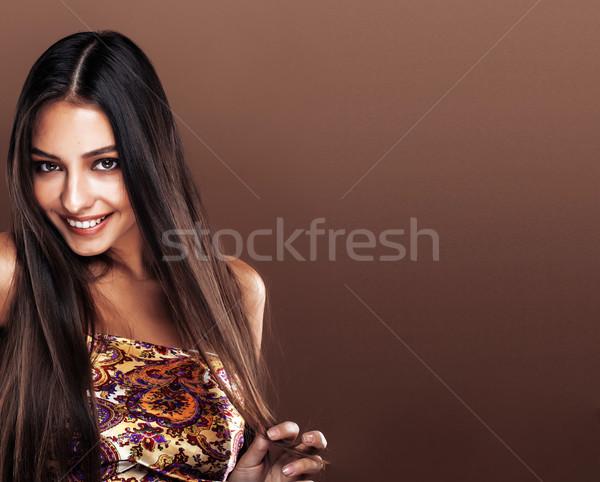 cute happy young indian woman in studio close up smiling, fashion mulatto smiling Stock photo © iordani