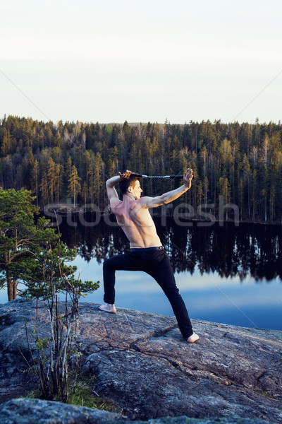 middle age man doing sport yoga on the top of the mountain, lifestyle people outdoor, summer wild na Stock photo © iordani