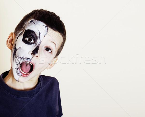 little cute boy with facepaint like skeleton to celebrate hallow Stock photo © iordani