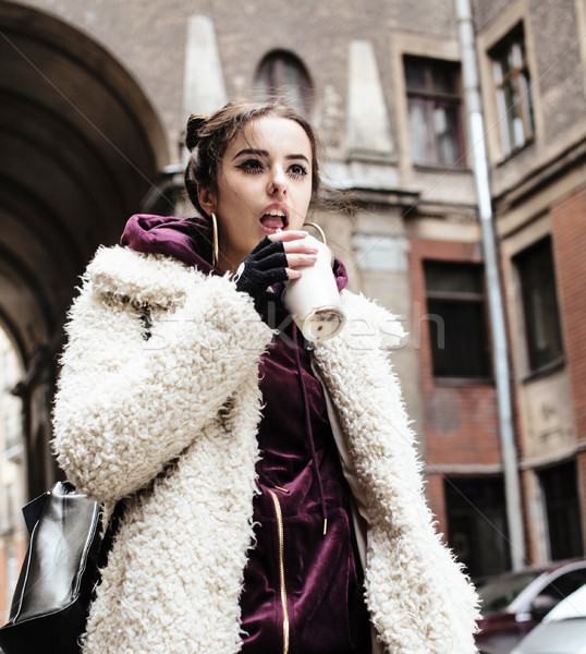 young pretty stylish teenage girl outside on city street fancy f Stock photo © iordani