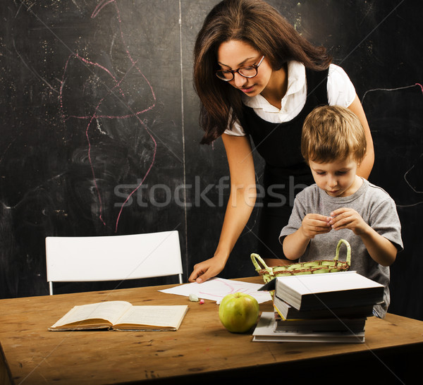 little cute boy in glasses with young real teacher, classroom studying Stock photo © iordani