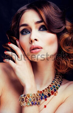 beauty rich woman with luxury jewellery looks like mature Stock photo © iordani