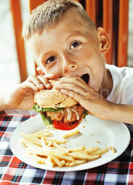 little cute boy 6 years old with hamburger and french fries maki Stock photo © iordani