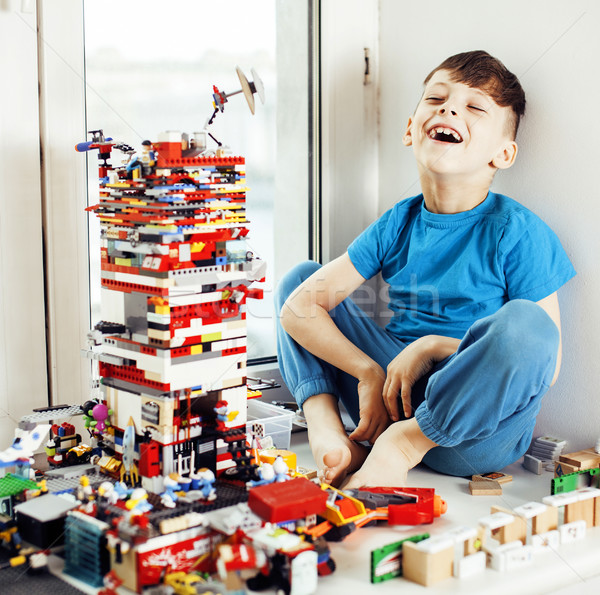 little cute preschooler boy playing with toys at home happy smiling kid, lifestyle people concept Stock photo © iordani