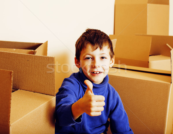 Stock photo: little cute boy in empty room, remoove to new house. home