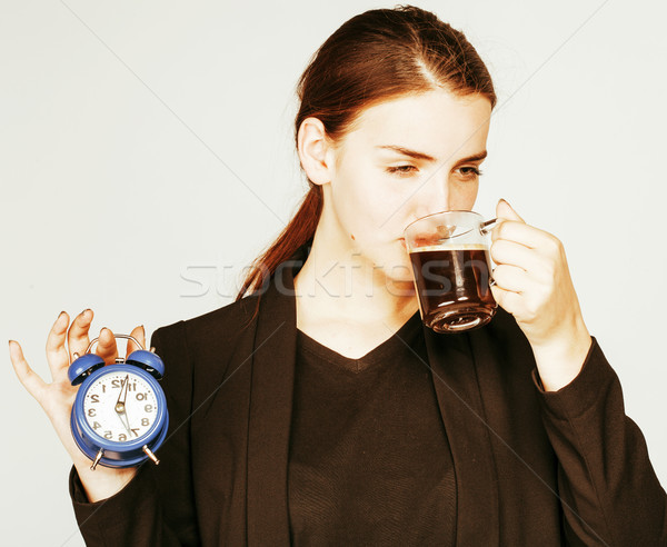 Stock photo: young beauty woman in business style costume waking up for work