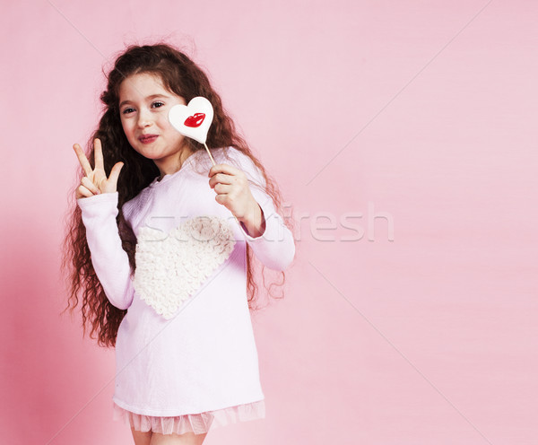 Stock photo: little cute girl with candy on pink background posing emotional, lifestyle people concept