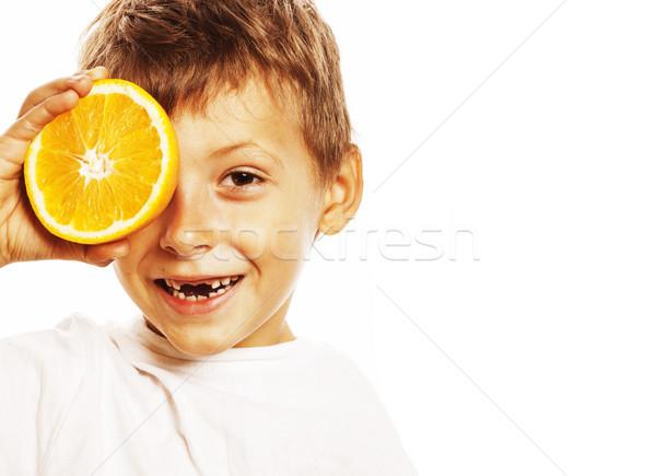 little cute boy with orange fruit double isolated on white smili Stock photo © iordani