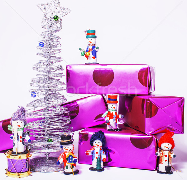 little sweet stylish snowmen toys with purple gifts and silver t Stock photo © iordani