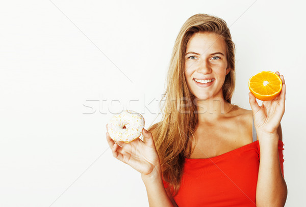 young blonde woman choosing between donut and apple fruit isolat Stock photo © iordani