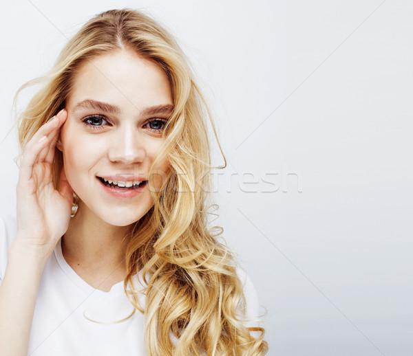 Jonge mooie blond tienermeisje poseren Stockfoto © iordani