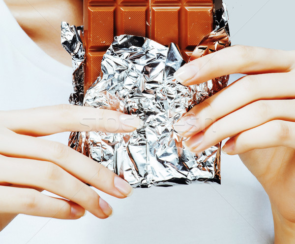 Nő eszik csokoládé közelkép kezek manikűr Stock fotó © iordani