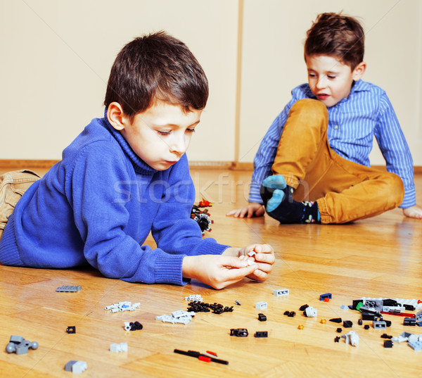 funny cute children playing toys at home, boys happy smiling, first education role lifestyle  Stock photo © iordani