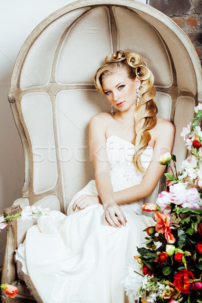 Stock photo: beauty young bride alone in luxury vintage interior with a lot of flowers close up