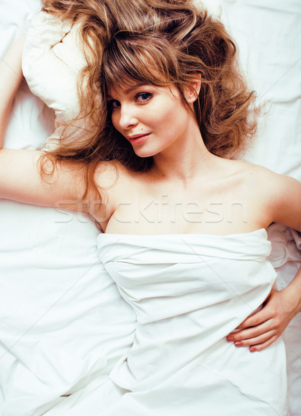 crying woman laying in bed, winter depression holding head with hands, having hangover Stock photo © iordani