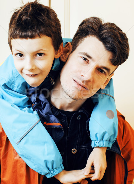 young handsome father with his son fooling around at home, lifes Stock photo © iordani
