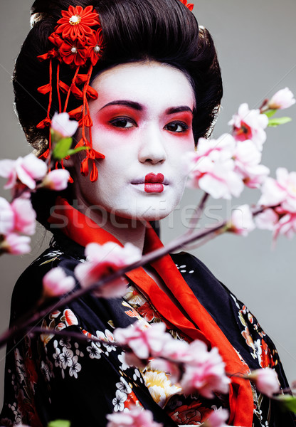 young pretty geisha in black kimono among sakura, asian ethno  Stock photo © iordani