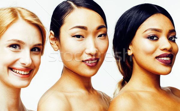 three different nation woman: asian, african-american, caucasian together isolated on white backgrou Stock photo © iordani