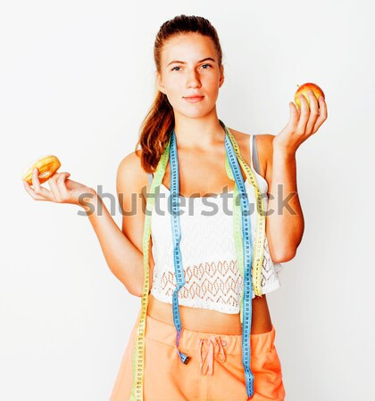 woman measuring waist with tape on knot like a gift, tan isolated close up white background, diet pe Stock photo © iordani